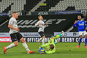 Cardiff City goalkeeper Alex Smithies (12) dives at the feet of Martyn Waghorn of Derby County  (9) to claim the ball during the EFL Sky Bet Championship match between Derby County and Cardiff City at the Pride Park, Derby, England on 28 October 2020.