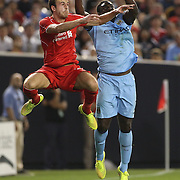Jack Robinson, (left), Liverpool, challenges for a header with Micah Richards, Manchester City, during the Manchester City Vs Liverpool FC Guinness International Champions Cup match at Yankee Stadium, The Bronx, New York, USA. 30th July 2014. Photo Tim Clayton