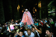 The statue of Saint Sara is carried by Gitan pilgrims from the church during the Gypsy Pilgrimmage of Saintes Maries de la Mer<br /><br />Europe, France, Camargue, Saintes Maries de la Mer, Gypsy Pilgrimmage 'Pelerinage des Gitans aux Saintes Maries de la Mer'. Gypsies from all over the world come to celebrate their patron Saint Sara who is carried by them from the church to the sea-shore. May 24th and 25th every year