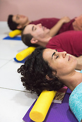 November 16, 2016 - People at yoga class resting head on block (Credit Image: © Aziz Ary/Image Source via ZUMA Press)