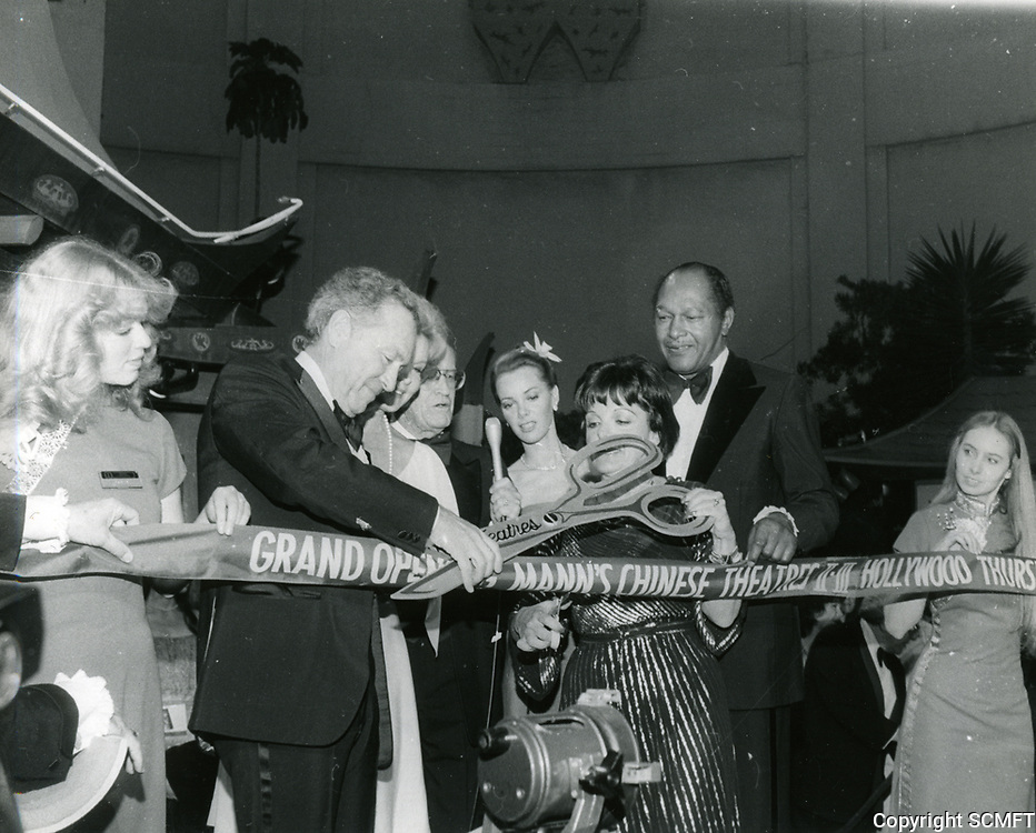 """1979 Ted Mann helps Councilwoman Peggy Stevenson cut the ribbon for the grand opening of Mann's Chinese Theaters #2 & #3  during the premiere of """"Hurricane"""""""