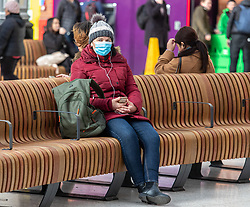 © Licensed to London News Pictures. 16/03/2020. London, UK. A traveller in mask at a quiet Victoria Station this morning as Government ministers warn that over 70s will face self-isolation for weeks as the Coronavirus disease pandemic continues . Photo credit: Alex Lentati/LNP