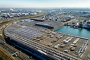 Nederland, Zuid-Holland, Rotterdam, 18-02-2015. Brittaniehaven met terrein van Cobelfret (voorheen Broekman automotive). Opslag en overslag van personenauto's, voorbereiding levering auto's aan dealers in geheel Europa. Onderdeel van Rotterdam Car Terminal (RCT).<br /> Rotterdam Car Terminal (RCT). Storage and handling of cars, preparing delivery of vehicles to dealers.<br /> luchtfoto (toeslag op standard tarieven);<br /> aerial photo (additional fee required);<br /> copyright foto/photo Siebe Swart