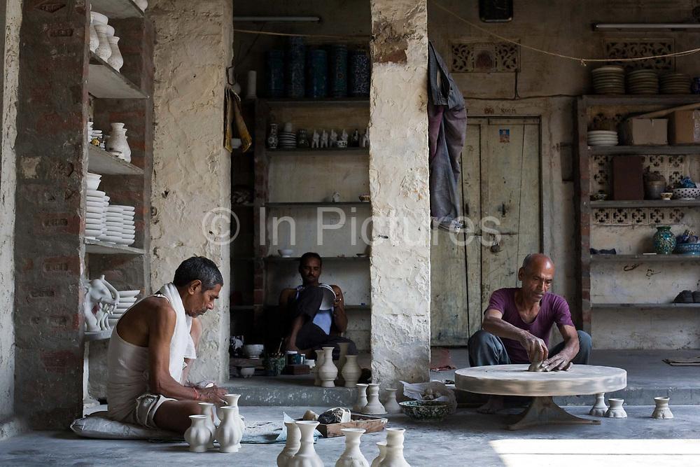 Artisan Potters at work at a factory in Sanganer, Jaipur, India