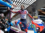 Russia's Alexander Tretiakov climbs into the crowd to celebrate his gold medal win with fans after the men's skeleton at the Sochi 2014 Winter Olympics on February 15, 2014 in Krasnaya Polyana, Russia.  (UPI)
