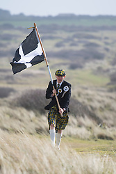 © Licensed to London News Pictures. 05/03/2017. PERRANPORTH, CORNWALL, UK.  St Pirans flag blowing in the gale. St. Piran's Day in Cornwall. St Piran is the patron Saint of Sinners in Cornwall and it is his flag that is recognised as the Cornish flag. Today his arrival from Ireland to Cornwall is celebrated across Cornwall especially in Perranporth where it is believed that he landed. He set up an Oratory and a Church the remains of which have been recently uncovered in the sand dunes at Perranporth..  Photo credit: MARK HEMSWORTH/LNP