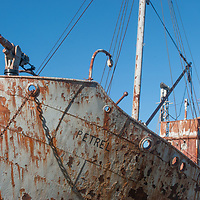 A harpoon gun sits on the bow of an abandoned whaling ship at Grytviken, South Georgia, Antarctica.