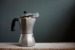 Coffee pot with Euros inside (Credit Image: © Image Source/Ian Nolan/Image Source/ZUMAPRESS.com)