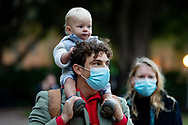 Protester wearing protective face mask with small child prepares to march on Parliament House at the Archibald Fountain in Hyde Park on 02 June, 2020 in Sydney, Australia. Black Lives Matter protest was arranged by Australian Communist Party with Australia's First Nations People following the killing of an unarmed black man George Floyd at the hands of a police officer in Minneapolis, Minnesota. (Photo by Pete Dovgan/ Speed Media)
