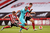 Football - 2019 / 2020 Premier League - Sheffield United vs Tottenham Hotspur<br /> Erik Lamela of Tottenham Hotspur competes with Ben Osborn and Sander Berge of Sheffield United, at Bramall Lane.<br /> <br /> COLORSPORT/PAUL GREENWOOD