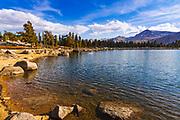 Hiker exploring Muir Lake in the Cottonwood Lakes Basin, John Muir Wilderness, California USA