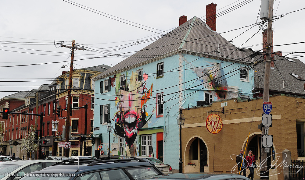 A view of works by Alexandros Vasmoulakis (left) and CASE (dove) in downtown Portsmouth, NH