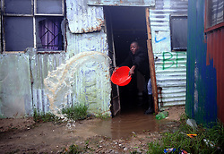 South Africa - Cape Town - 10 July 2020 - Sivuyile Nongqoqo trying to take water out of his home in Burundi in Mfuleni, about 520 houses in Burundi Informal Settlement are flooded. Photographer Ayanda Ndamane African news agency (ANA)