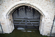 Entrance to Traitors Gate at the Tower of London in London, England, United Kingdom. Many prisoners of the Tudors entered the Tower of London through the Traitors Gate. The gate was built by Edward I, to provide a water gate entrance to the Tower, part of St. Thomass Tower, which was designed to provide additional accommodation for the royal family.