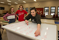 """Noel Murphy, Gabe Fraser and Meredith Imbimbo work through their list of items during """"Tech Day"""" for Once Upon a Mattress at Belmont High School on Saturday.  (Karen Bobotas/for the Laconia Daily Sun)"""