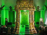 "15 JULY 2015 - THONBURI, BANGKOK, THAILAND:  The ""mihrab,"" a niche which indicates the direction of Mecca, in Bang Luang Masjid (Masjid is the Thai word for mosque.) Located on the west bank of the Chao Phraya River and built in the reign of King Rama I (1782-1809), Bangluang Mosque is one of the oldest mosques in Bangkok and is unique because it's designed in a traditional Thai style and decorated with Thai, European, and Chinese art. The Mosque carries Islamic symbolic features such as 30 pillars, 12 windows and 1 door which represent the numbers of chapters in the Koran and the 13 regulations of Islamic worshipping ritual.    PHOTO BY JACK KURTZ"