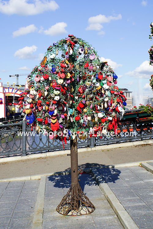 Love locks on happiness trees on Luzhkov Bridge, Moscow, Russia
