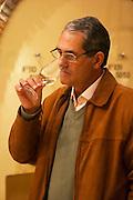 The owner manager Edgardo J Etcheverry tasting a glass of wine. Bodega Castillo Viejo Winery, Las Piedras, Canelones, Uruguay, South America