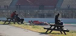 Fans watch Ferrari's Sebastian Vettel during day one of pre-season testing at the Circuit de Barcelona-Catalunya.