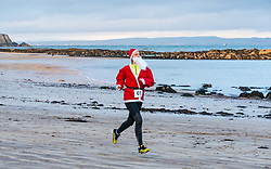 North Berwick, East Lothian, Scotland, United Kingdom, 28 November 2019. The annual Santa Run sees people and families running along West beach and the coastline to raise money to fund a Project Trust trip for school leaver Beth Poole, 18 years of age, to go to Ghana to teach English and maths at a junior school in the Volta region.<br /> Sally Anderson | EdinburghElitemedia.co.uk