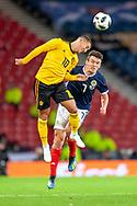 Eden Hazard (#10) of Belgium and John McGinn (#7) of Scotland contest a header during the International Friendly match between Scotland and Belgium at Hampden Park, Glasgow, United Kingdom on 7 September 2018.