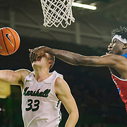 Marshall Thundering Herd guard Jon Elmore (33) gets a mouthful from Louisiana Tech Bulldogs forward Anthony Duruji (10) during the second period of the LA Tech-Marshall men's basketball game at Marshall University in Huntington, W.V., on Saturday, December 30, 2017.