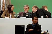 13 MAY 1999 - BIELEFELD, GERMANY:<br /> Kerstin Müller, B90/Grüne Fraktionsvorsitzende, Joschka Fischer, B90/Grüne, Bundesaußenminister, und Rezzo Schlauch, B90/Grüne Fraktionsvorsitzender, und der Schutz von Bodyguards auf der Bundesdelegiertenkonferenz von Bündnis 90/Die Grünen, Stadthalle<br /> Kerstin Mueller, Chairwomen of the green parlaimentary group, Joschka Fischer, Federal Minister of Foreign Affairs, and Rezzo Schlauch, Chairmen of the green parlaimentary group, are protected a bodyguard, conference of the german green party<br /> IMAGE: 19990513-01/04-01<br /> KEYWORDS: Parteitag, Farbe