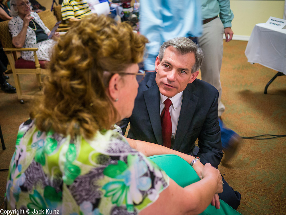 09 AUGUST 2012 - SCOTTSDALE, AZ:   Congressman DAVID SCHWEIKERT (R-AZ) campaigns before a candidate forum at an assisted living facility in Scottsdale, AZ, Thursday. Republican Congressmen Ben Quayle and David Schweikert are facing each other in Arizona's Aug. 28 Republican primary. They are vying for the right to represent Arizona's 6th Congressional District. Both men are incumbent freshmen Congressmen. They were thrown into the same district during the redistricting process after the 2010 census. Both men are conservatives courting the Tea Party vote.    PHOTO BY JACK KURTZ