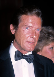 """Actor Sir Roger Moore, best known for playing James Bond, has died aged 89, his family has announced after """"a short but brave battle with cancer"""". 24 May 2017 Pictured: Rooger Moore. Roger Moore Attending Friars Club Roast at the waldorf Astoria Hotel, New York City. Photo credit: MEGA TheMegaAgency.com +1 888 505 6342"""