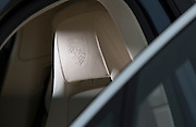 Image of a 2010 Porsche Panamera embossed logo on the headrest, California, America west coast by Randy Wells