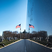 The Korean War Veterans Memorial on the National Mall in Washington DC, with a reflection on the black granite Mural Wall.