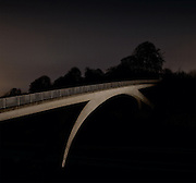 Concrete footbridge over motorway, Hertfordshire, England. Personal Project. Canon 5dMKII 24mm TSL. 10 minute exposure. f9