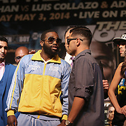 Boxer Adrien Broner (yellow) faces off against opponent Carlos Molina during the undercard final press conference for the Mayweather & Maidana boxing match at the Hollywood Theater, inside the MGM Grand hotel on Thursday, May 1, 2014 in Las Vegas, Nevada.  (AP Photo/Alex Menendez)