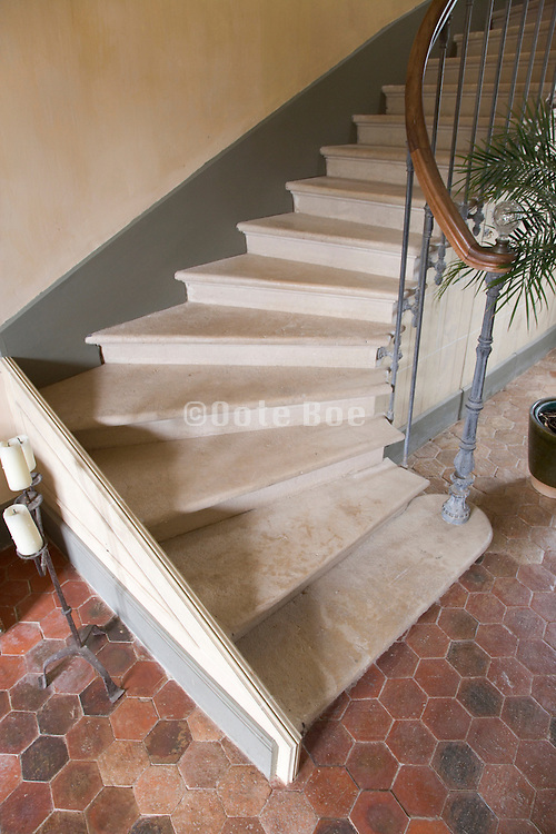 detail of an old stone stair with old tile floor