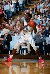 CHAPEL HILL, NC - FEBRUARY 05: Nassir Little #5 of the North Carolina Tar Heels carries the ball during a game against the North Carolina State Wolfpack on February 05, 2019 at the Dean Smith Center in Chapel Hill, North Carolina. North Carolina won 113-96. North Carolina wore retro uniforms to honor the 50th anniversary of the 1967-69 team. (Photo by Peyton Williams/UNC/Getty Images) *** Local Caption *** Nassir Little