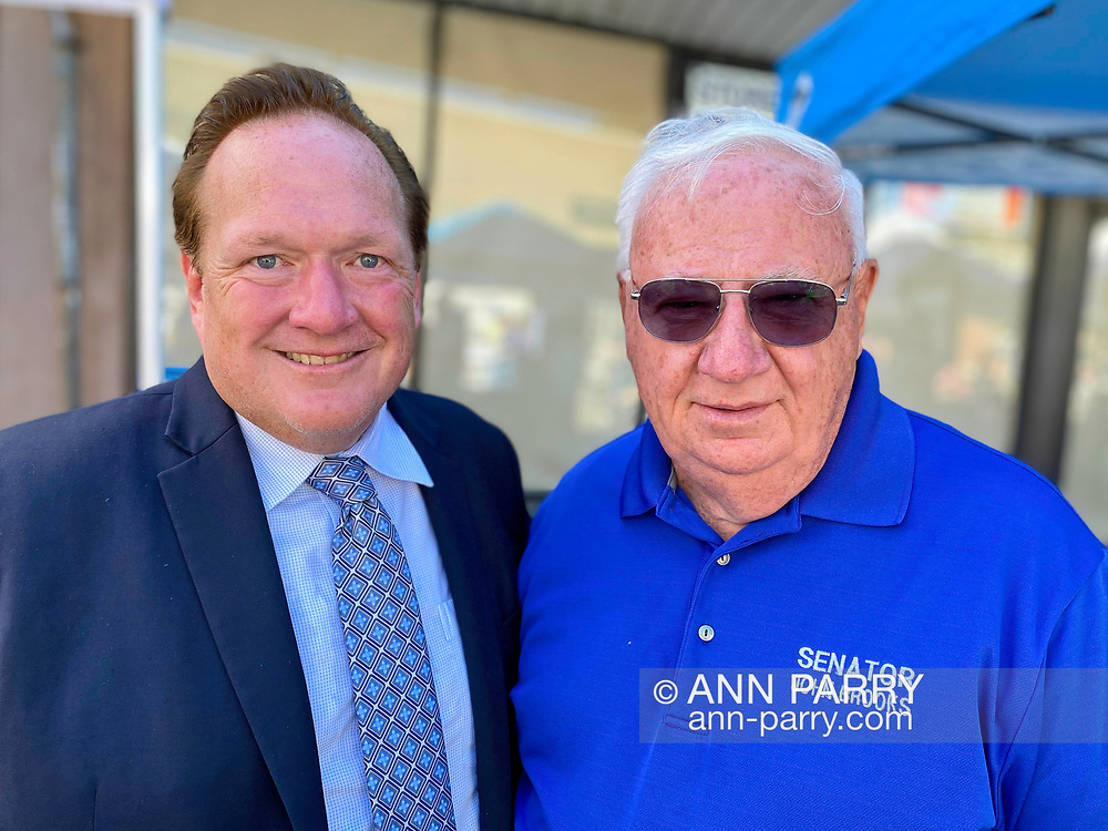 Bellmore, New York, U.S.  September 25, 2021.  L-R JASON ABELOVE, the Democratic candidate for Town of Hempstead Supervisor, and NYS Senator JOHN BROOKS pose for photo at 34th Annual Bellmore Family Street Festival.