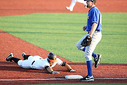11 July 2012:  Frank Phister (Schaumburg Boomers) slides into 3rd with pitcher Gary Lee (Washington Wild Things) covering during the Frontier League All Star Baseball game at Corn Crib Stadium on the campus of Heartland Community College in Normal Illinois