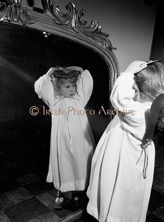'Little Angels'- children from the Civics Institute of Ireland's nursery centres, sing at the opening of the crib at the Mansion House. .One Little Angel, Ann Ryan, checks that her halo is straight before her big appearance..04.12.1969