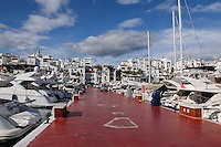 Marina, wharf, dock, berthing, pontoon, quay,  Puerto Banus, Marbella, Costa del Sol, Spain, December, 2016, 201612193214<br /> <br /> Copyright Image from Victor Patterson, 54 Dorchester Park, Belfast, UK, BT9 6RJ<br /> <br /> t1: +44 28 9066 1296 (from Rep of Ireland 048 9066 1296)<br /> t2: +44 28 9002 2446 (from Rep of Ireland 048 9002 2446)<br /> m: +44 7802 353836<br /> <br /> e1: victorpatterson@me.com<br /> e2: victorpatterson@gmail.com<br /> <br /> The use of any of my copyright images is subject to my Terms & Conditions. It is IMPORTANT that you familiarise yourself with them. They are available at my website, victorpatterson.com.<br /> <br /> None of my copyright images may be used on the Internet unless they are visibly watermarked, i.e. © Victor Patterson within the body of the image. My metadata, denoting my copyright must NOT be deleted. <br /> <br /> Web use is extra at currently recommended NUJ rates. Maximum permitted web size is<br />  400kb. <br /> <br /> Images must not be passed on to a third party - they are for the use of the authorised recipient only.