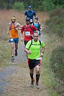Kerhonkson, New York - Jason Beaupre of Gardiner takes the lead at Minnewaska State Park Preserve in the Shawangunk Ridge Trail Run/Hike 20-mile race on Sept. 20, 2014.