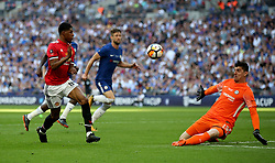 Manchester United's Marcus Rashford (left) has a chance on goal during the Emirates FA Cup Final at Wembley Stadium, London.