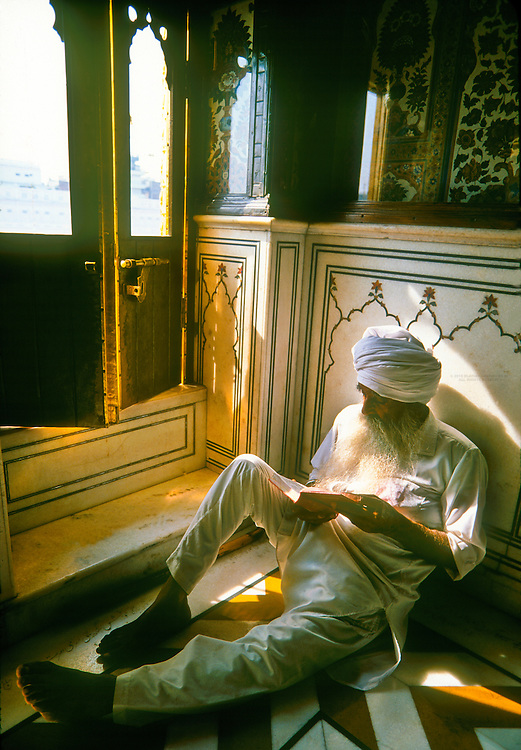 Sikh man praying inside the Golden Temple (the holiest Sikh shrine), Amritsar, Punjab, India