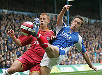 Photo: Lee Earle.<br /> Portsmouth v Reading. The Barclays Premiership. 28/10/2006. Reading's Steve Sidwell (L) clashes with Sean Davis.