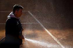 May 3, 2018 - Estoril, Portugal - A man takes care of the pithc during the game of Kevin Anderson from South Africa vs Stefanos Tsitsipas from Greece during the Millennium Estoril Open tennis tournament in Estoril, outskirts of Lisbon, Portugal on May 1, 2018  (Credit Image: © Carlos Costa/NurPhoto via ZUMA Press)