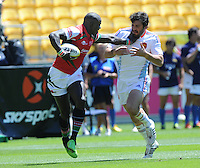 Kenya's Willy Ambaka fends off a French player at the IRB International Rugby Sevens, Westpac, Wellington, New Zealand, Friday, February 01, 2013. Credit:SNPA / Ross Setford