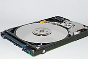 Inside an open data storage computer portable hard disk drive. View of spindle and arm. <br />
