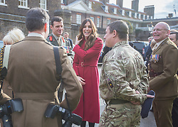 © Licensed to London News Pictures. 07/11/2013.  The Duchess of Cambridge met members of the Armed Forces today at Kensington Palace as the Royal British Legion aimed to collect a million pounds in one day.  The Royal couple then popped onto a Poppy bus and met with former and serving soldiers at High Street Kensington. Photo credit: Alison Baskerville/LNP