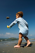 Two year baby boy plays on the beach