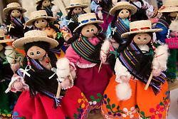 Dolls on display at market, Cuenca, Ecuador, South America