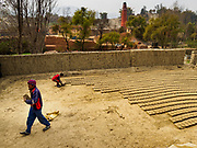 09 MARCH 2017 - BAGMATI, NEPAL:  A worker stacks unbaked bricks at a brick factory in Bagmati, near Bhaktapur. There are almost 50 brick factories in the valley near Bagmati. The brick makers are very busy making bricks for the reconstruction of Kathmandu, Bhaktapur and other cities in the Kathmandu valley that were badly damaged by the 2015 Nepal Earthquake. The brick factories have been in the Bagmati area for centuries because the local clay is a popular raw material for the bricks. Most of the workers in the brick factories are migrant workers from southern Nepal.           PHOTO BY JACK KURTZ